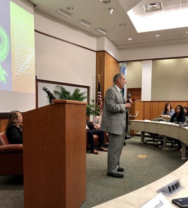 Florida Mediator Carl Schwait awards scholarship and discusses a Florida Bar mental health and wellness initiative. His presentation was part of an April 10 event at The University of Florida Levin College of Law. Photo by Ren�e Thompson.