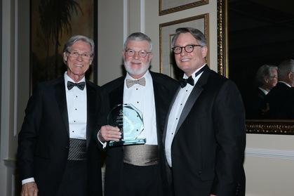 Wayne Hogan, from left, recipient Bob Cole, and ABOTA local chapter President Curry Pajcic of Pajcic & Pajcic pose with the award.