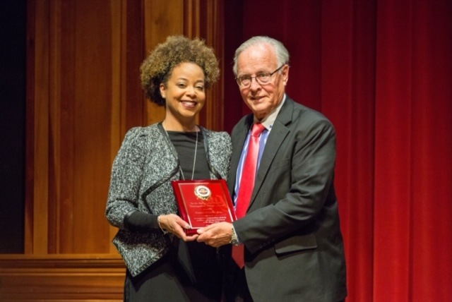2018 Faculty Recipient Joedreka Brown Speights presents the 2019 Dr. Martin Luther King, Jr. Distinguished Service Award to this year's faculty winner, mediator Donald J. Weidner.