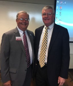 "Mediator Robert A. ""Bob"" Cole, right, retired County Court Judge Charles Cofer"