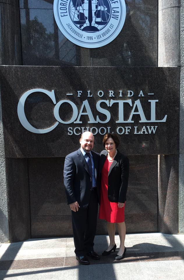 Lawrence Kolin and A. Michelle Jernigan pose in front of Florida Coastal School of Law