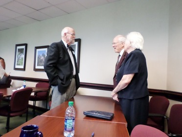 Mediator Howard Marsee, left, chats with Alex and Anna Jernigan, parents of mediator Michelle Jernigan.