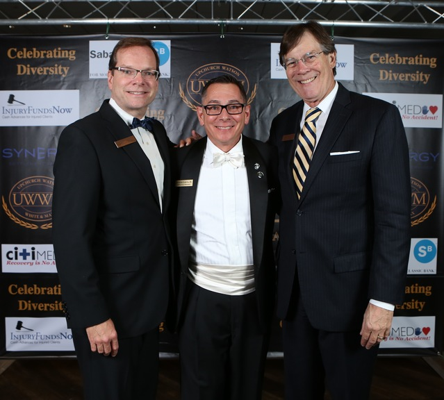 "UWWM shareholder Richard Lord (from left) and mediators Arthur Garcia, Jr., and Ricardo Cata take some time out from the festivities to stand in front of the ""step and repeat"" panel."